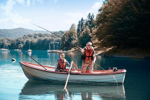 Two men relaxing and fishing 928826678