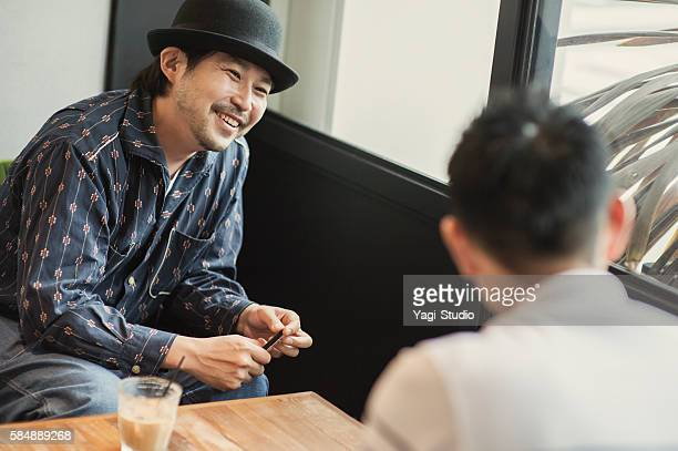 Two men relaxing in a Cafe