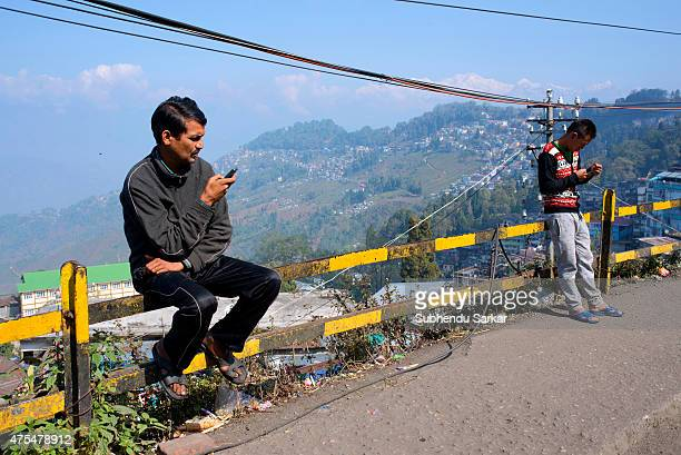 Two men remain busy with their mobile phones in Darjeeling Darjeeling Darjeeling is a town in India's West Bengal state in the Himalayan foothills...