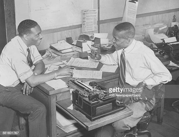 Two men reporters at desks at the Afro American newspaper offices in Baltimore Baltimore Maryland 1945