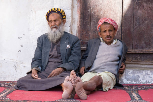 Two men resting at courtyard of mosque