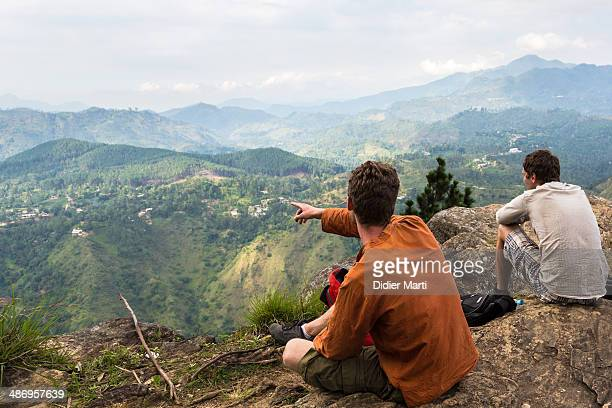 Two men resting at the top of Ella s gap in Sri Lanka