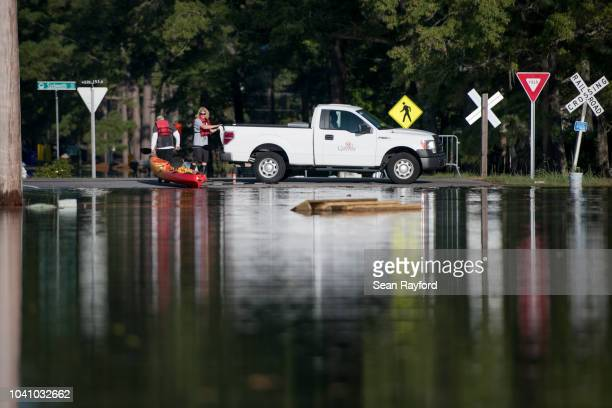 Two men return from a kayak mission in floodwaters caused by Hurricane Florence on September 26, 2018 in Conway, South Carolina. Nearly two weeks...