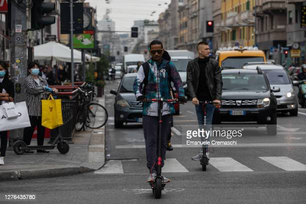 Two men ride electric scooters on a pop-up bike lane on Corso Buenos Aires on September 23, 2020 in Milan, Italy. Since the end of lockdown Milan...