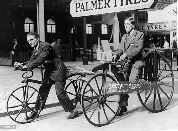Two men ride on early bicycles known as the Hobby Horse and 'Boneshaker' The Hobby Horse was invented by Karl Von Drais in 1818 and was operated by...