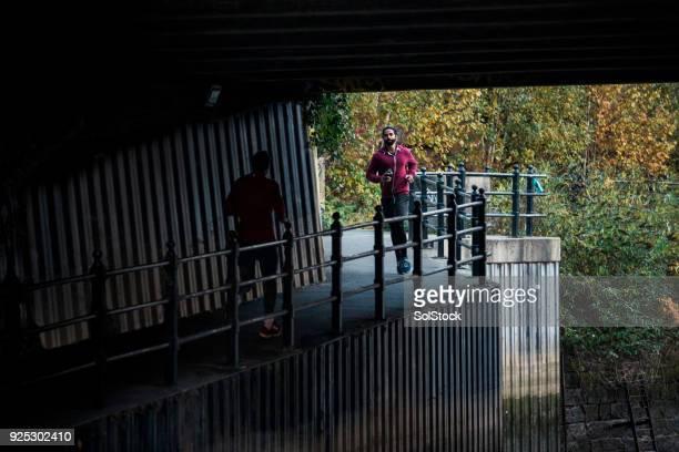 Two Men Running At Dusk