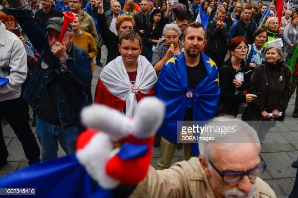 Two men seen covered in both Polish and European Union flags People demonstrate against reforms of the Supreme Court and demand for free courts in...