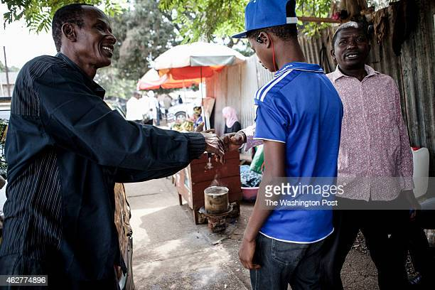 Two men shake hands on the street on Conakry Guinea on Wednesday January 21 2015