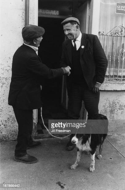 Two men shake hands outside a pub in Dowra County Cavan Ireland 1974