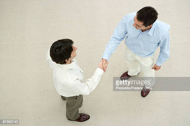 two men shaking hands, overhead view - smart casual stock pictures, royalty-free photos & images