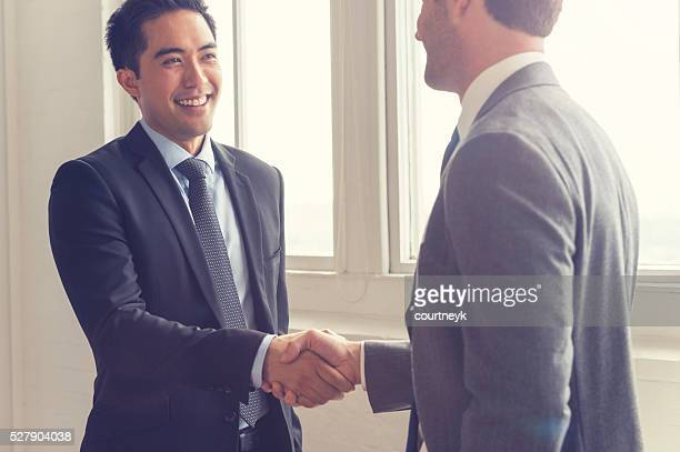 Two men shaking hands.