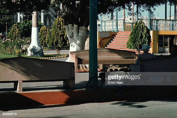 Two men share a park bench in Mexico 1960s