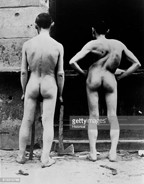 Two men show their injuries inflicted during the destruction of the Warsaw Ghetto by SS troops