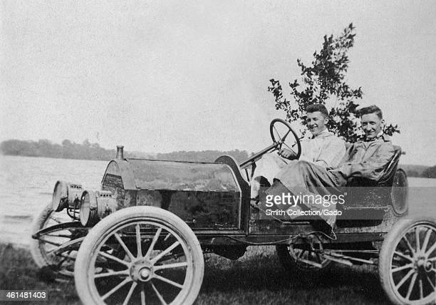 Two men sit in a Ford Model T Speedster automobile near a lake California 1912