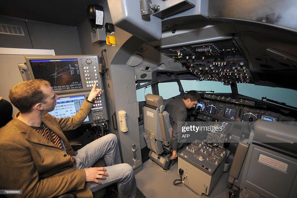Two men sit inside the new Boeing 737 NG full flight