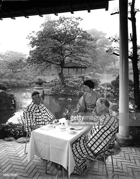Two men sitting at a table at The Japanese Inn in Japan 1955