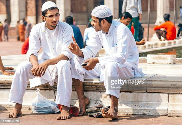 two men sitting at the jama masjid mosque, india - agra jama masjid mosque stock pictures, royalty-free photos & images