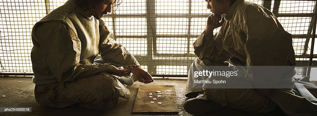 Two men sitting face to face : Stockfoto
