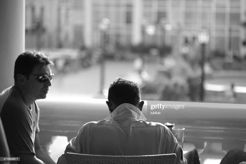 Two men sitting in a restaurant- Santiago de Cuba : Stock Photo