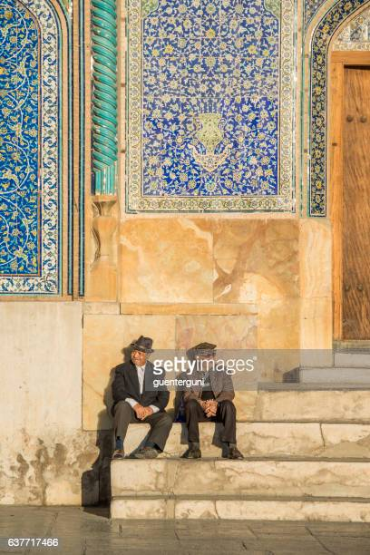 Two men sitting in front of Sheikh Lotfollah Mosque, Isfahan
