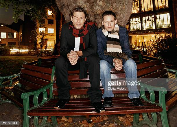 Two Men Sitting on a Wooden Bench in Soho Square