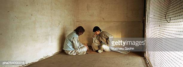 two men sitting - tunic stock pictures, royalty-free photos & images