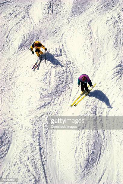 two men skiing bumps - mont tremblant stock pictures, royalty-free photos & images