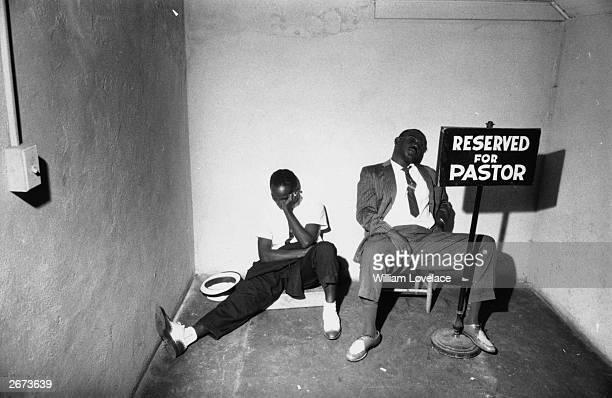Two men sleeping in the pastor's car park during a siege of the First Baptist Church in Montgomery, Alabama by a white mob of three thousand during...