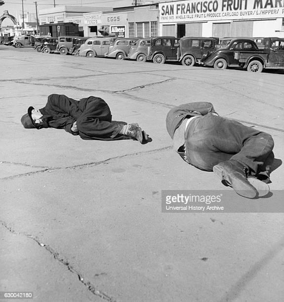 "Two Men Sleeping on Sidewalk of ""Skid Row"", Howard Street, San Francisco, California, USA, Dorothea Lange for Farm Security Administration, February..."