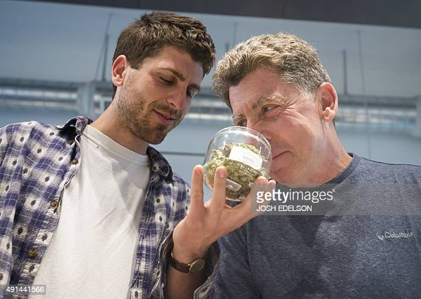 two men smell marijuana buds at Farma a marijuana dispensary in Portland Oregon on October 4 2015 As of October 1 2015 a limited amount of...