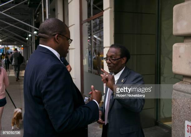 Two men speak on the sidewalk June 14 2018 in New York City