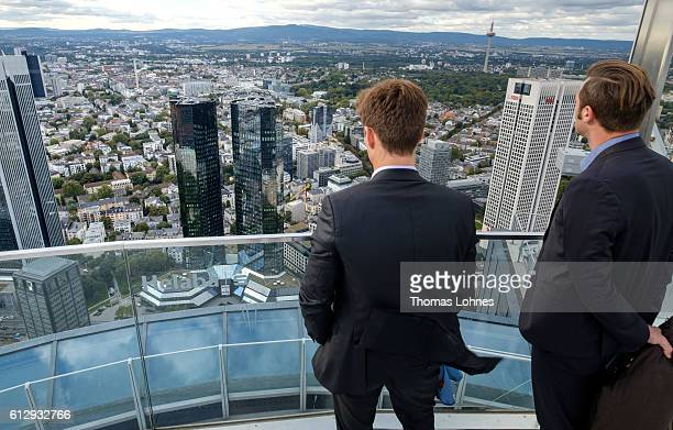 Two men stand at the viewing platform of the 'Maintower' and look to the headquarters of Deutsche Bank on October 5 2016 in Frankfurt Germany Banks...
