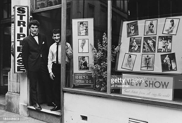 Two men stand in the doorway of a Soho strip club London circa 1969