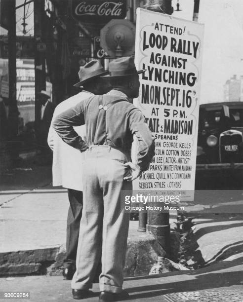 Two men stand next to a sign announcing a rally against the practice of lynching Chicago IL August 1946 The rally is to be held at the corner of...