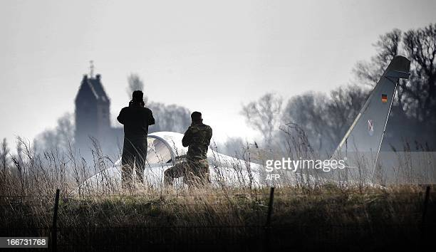 Two men stand on April 16 2013 near a fighter jet at the Leeuwarden Airbase near Leeuwarden Participants from The Netherlands Germany France Belgium...