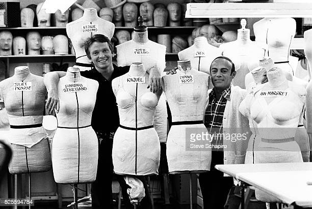 Two men stand with mannequins shaped like various actresses