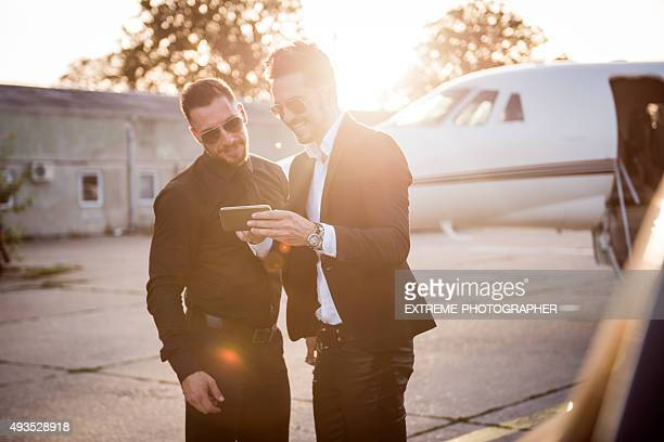 Two men standing at the airport