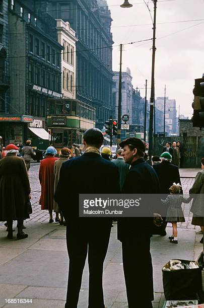 Two men stood talking on Argyll Street viewed east from Jamaica Street Glasgow 1955