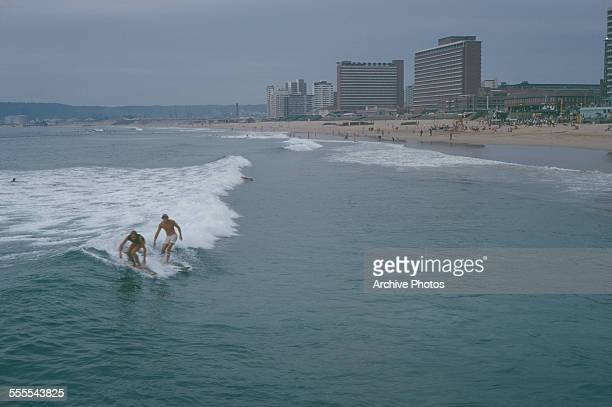 Two men surfing in Durban South Africa August 1969