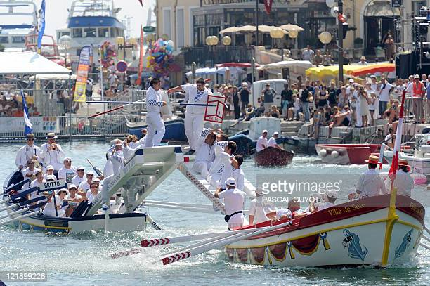 Two men take part in traditional water jousting in the French southern city of Sète on August 20 2011 The famous nautical jousting tournaments of...