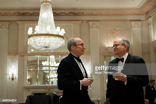 Two men talk before the Committee to Protect Journalists International Press Freedom Awards at the Waldorf Astoria on November 25 2014 in New York...