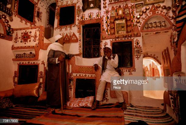 Two men talk in a traditional home April 2000 in Ghadames Libya
