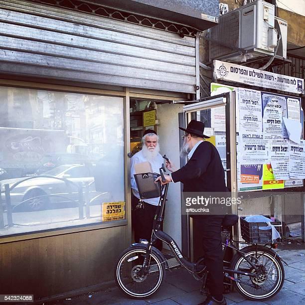 Two Men talking on Bnei Brak street, Israel