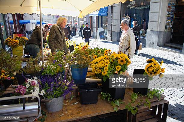 two men talking, open air flower market stand - vaud canton stock pictures, royalty-free photos & images