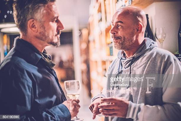 Two Men Talking to Each Other in a Wine Bar
