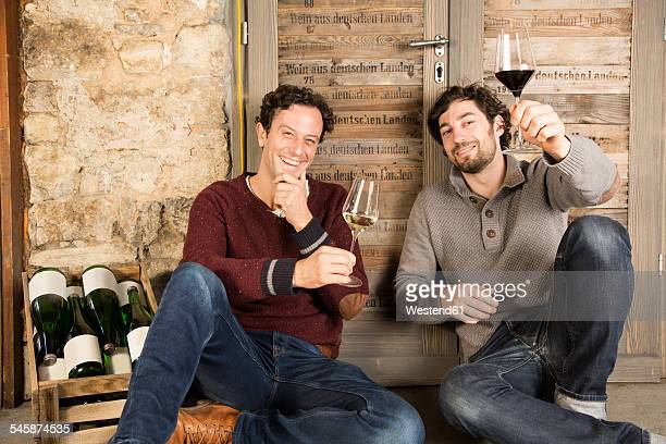 Two men tasting wine at wine estate