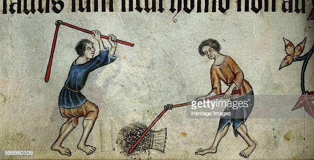 Two men threshing sheaf ca 1330 Found in the collection of British Library Artist Anonymous