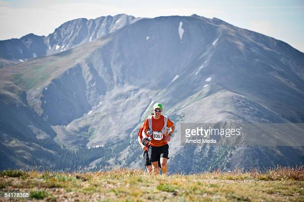 Two men trail running in the Rocky Mountains