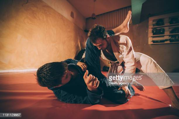 two men training brazilian jujitsu - wrestling stock pictures, royalty-free photos & images