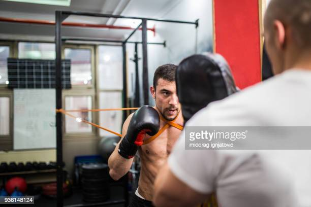 Two men training kickbox